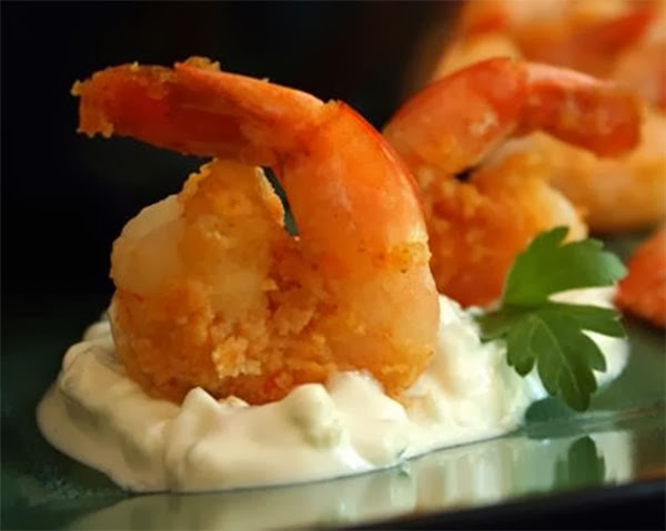 Buffalo Prawns with Blue Cheese Dip: Prawns (shrimp) in a spicy coating served on a blue cheese dressing bed