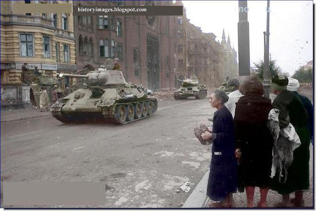Old German women watch  Russian tanks streets  Berlin May 1945