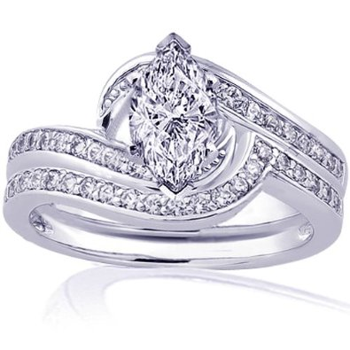 this marquise cut diamond wedding ring features 24 round cut diamonds set in a snail shape to border the marquise center stonethe band sits flush fit with