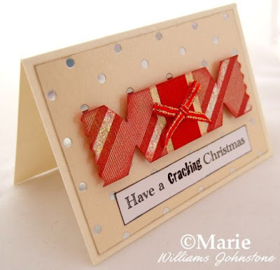 Handmade greetings card with red and gold cracker and cream polka background