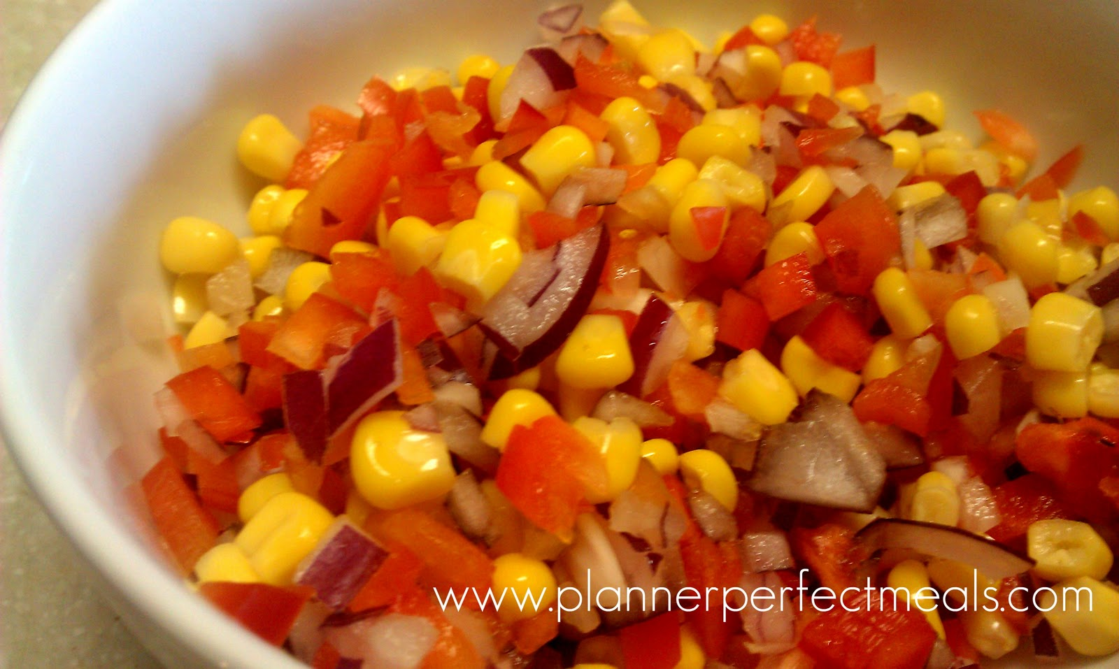 corn relish with red onion, corn and red bell pepper