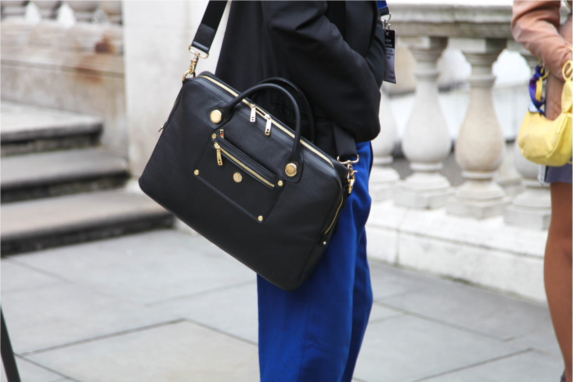 London Fashion Week street style leather bag with gold zipper and harness