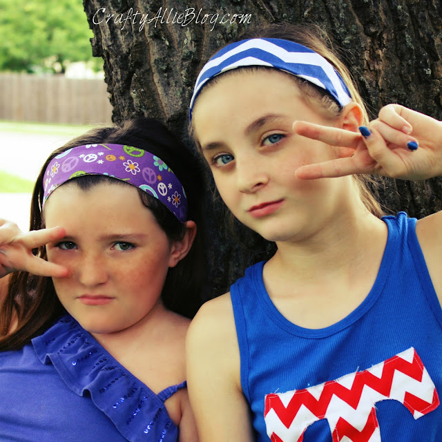 girls posing in fabric headbands peace sign