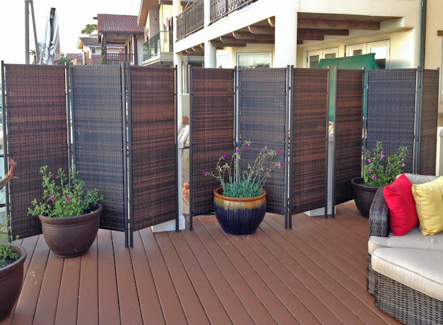 interesting terrace with folding backyard privacy screen from rattan material lush flowers on pot