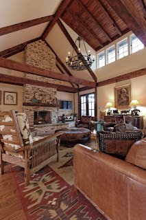 Appealing Living Room with Stone Rustic Fireplace Mantels and Brown Sofa under the Classic Iron Chandelier