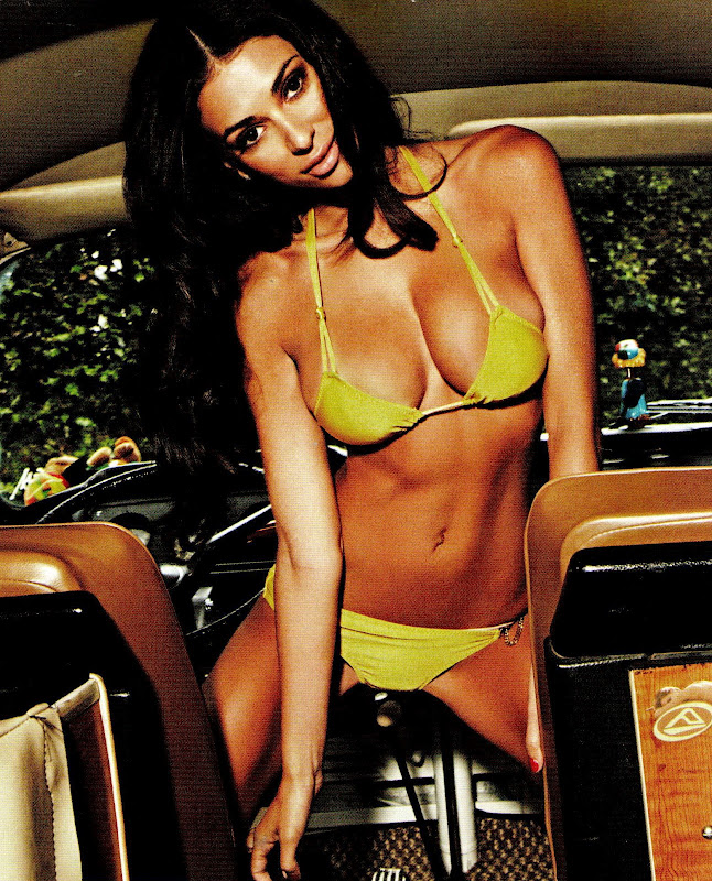 Georgia Salpa wearing a yellow bikini and posing in the car