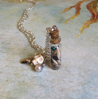 http://folksy.com/items/4397064-Mermaid-dreams-Glass-vial-necklace-