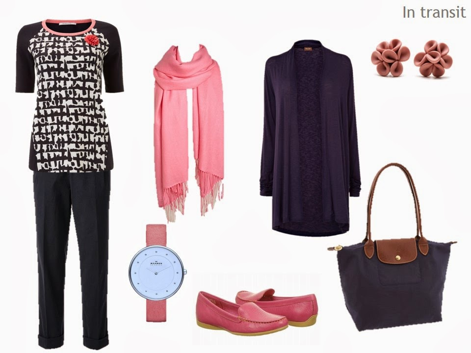 travel outfit in navy and coral, with a navy cardigan and pants, and coral scarf and loafers