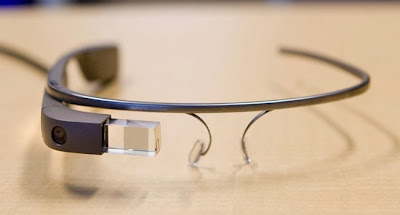 A black framed version of Google Glass, with the camera and screen visible.