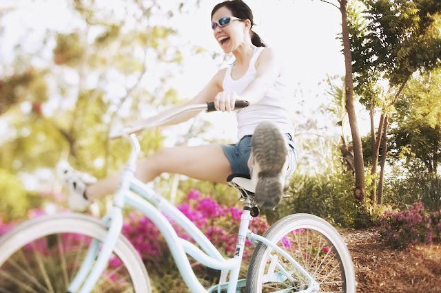 tips build self confidence breakup divorce woman bike happy