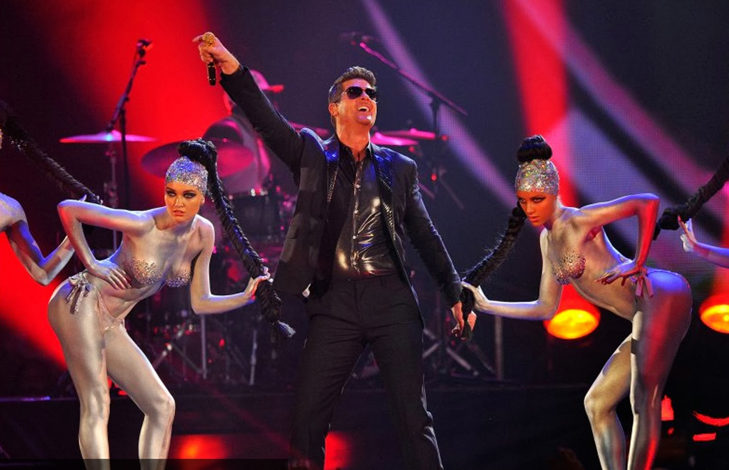 Even though Robin Thicke has called quits performing with Miley Cyrus, he  had sexy silver body painted dancers in crystallized nude bras dancing  alongside ...