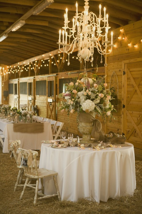 Mix christmas lights chandeliers and candles with wood hay