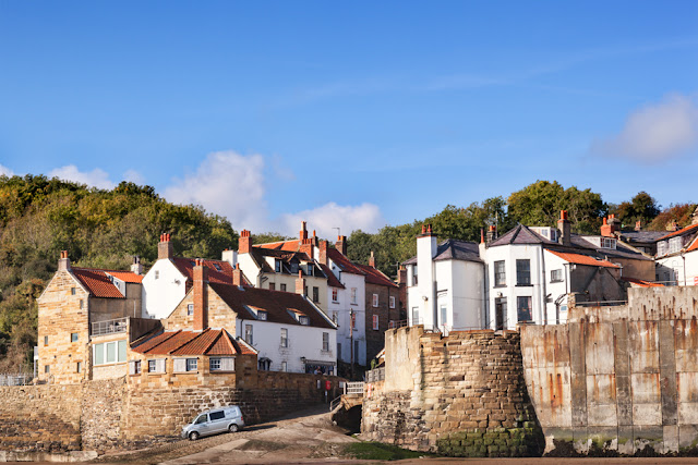 View of Robin Hood's Bay in the morning sunshine by Martyn Ferry Photography
