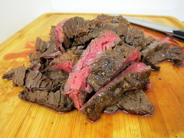 Southwestern Skirt Steak Recipe - skirt steak marinated in olive oil, soy sauce, onion powder, garlic, red pepper flakes, cumin and brown sugar - SOOOO good! Skirt steak is inexpensive and so tender and juicy. This is great as fajitas!