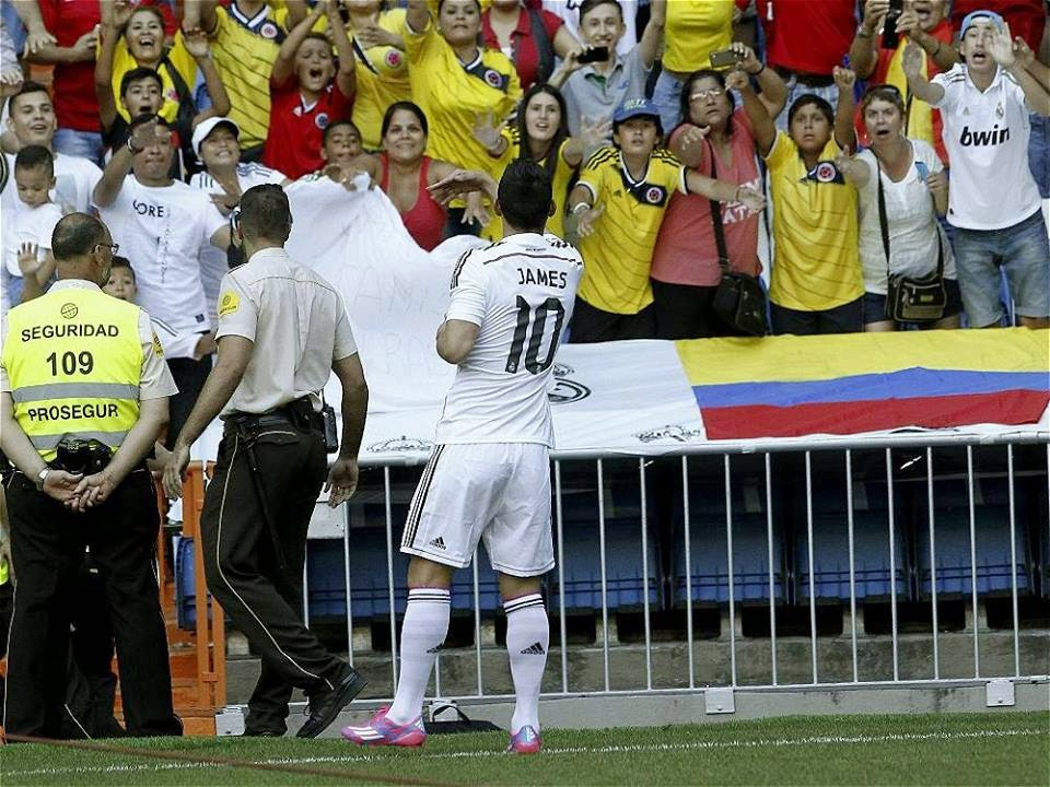 James Rodríguez is ecstatically greeted by Colombians after his unveiling as a Real Madrid player.