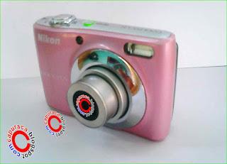 Memperbaiki penutup baterai Kamera Digital yang rusak