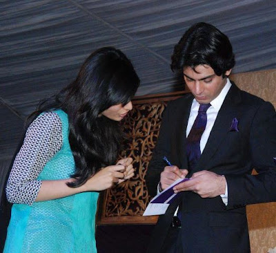 Fawad Afzal Khan signing autograph for a girl - Pakistan celebrities