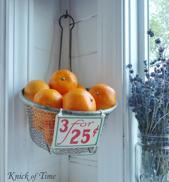 Repurposed Vintage Wire Baskets as Wall Fruit Baskets in Farmhouse Kitchen via KnickofTimeInteriors.blogspot.com
