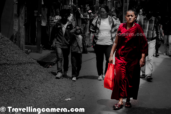 The little Lhasa in India, which is popularly known as Mcledoganj is also know for it's interesting street-walks through a different kind of culture. This Photo Journey is more about some interesting streets around Mcledoganj Town, so let's walk with these photographs...Mcledoganj is the home of the Tibetan Guru and leader His Holiness The Dalai Lama and the Tibetian government in exile. Under the Himalayas, snow covered Dhaluadhar Mountain Ranges, Mcledoganj is a beautiful hill station and a world known destination.Mcledoganj is more about a Tibetian Colony in this part of the country with highest importance. Mcledoganj has many institutions that tell the world about their great culture, medical practices, historical challenges, current way of living life and lot more other things. People from different parts of the world come to this place for learning their culture, Yoga, Meditation and different art forms... Above photograph is clicked inside Tibetian Museum near Residence of Him Holiness Dalai Lama !!!The cultural life in Dharamshala/Mcledoganj is colorful and rich in tradition. The fairs and festivals are occasions for relaxation. To the local Indian traditions, Tibetan refugees have added their own festivals such as Losar (which is Tibetan New Year) and His Holiness Dalai Lama's birthday which is celebrated on July 6 with the performance of Tibetan, Nepali and Gaddi dances revealing the cultural mosaic of Mcleodganj. More recently tourists and students from the west have added rock music, stage musicals and contribute other Western influences to this melting pot of peoples and cultures... These days different kinds of people can be seen on Mcledoganj streets and everyone having their specific styles/approaches...Mcledoganj streets are quite colorful and main color of these streets is Red. It's more because of Red religion of this land. Monks in red dresses can be seen all around and most of them keep doing some prayers, even while walking from one place to ot