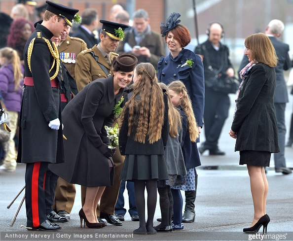 Prince William and Catherine, Duchess of Cambridge attend the St Patrick's Day Parade at Mons Barracks