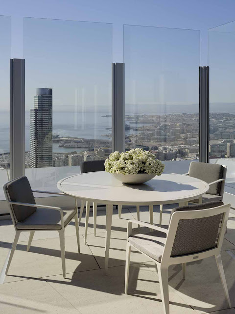 Ideal  weatherproof position with a quartet of aluminum Brown Jordan chairs surrounding a Brown Jordan metal table Custom made resin sofas and a low table