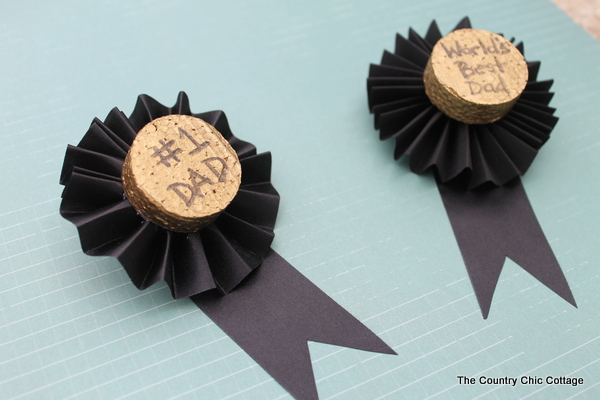 These Father's Day medals are a great craft for kids to help make for Dad. Turn the kids loose on the painting and text while you fold the ribbon and add a pin. Dad will be proud to wear these medals on his big day!