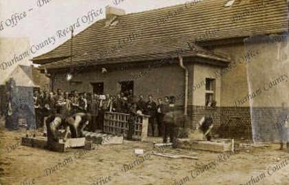 Outside the tin rooms, German orderlies enlarging the lockers, here all parcels were stacked and issued and tins stored, Graudenz, October 1918 (D/DLI 7/424/3(18))