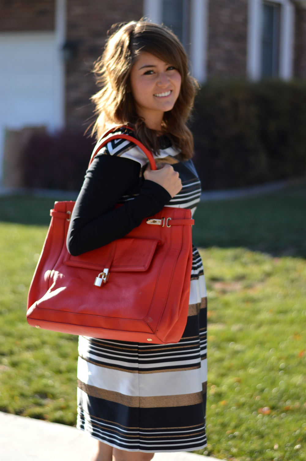 Black dress with red bag -  Inspiration I Think That The Neutral Black White And Gold In The Dress From Ivy Blu Go Well With The Bright Holiday Red Bag From Sole Society