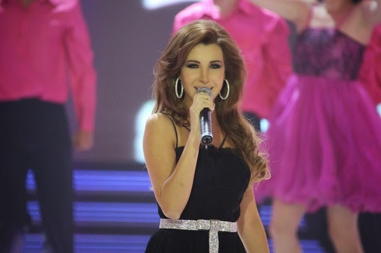 http://pictures4girls.blogspot.com/2014/10/nancy-ajram-at-miss-lebanon-2014.html