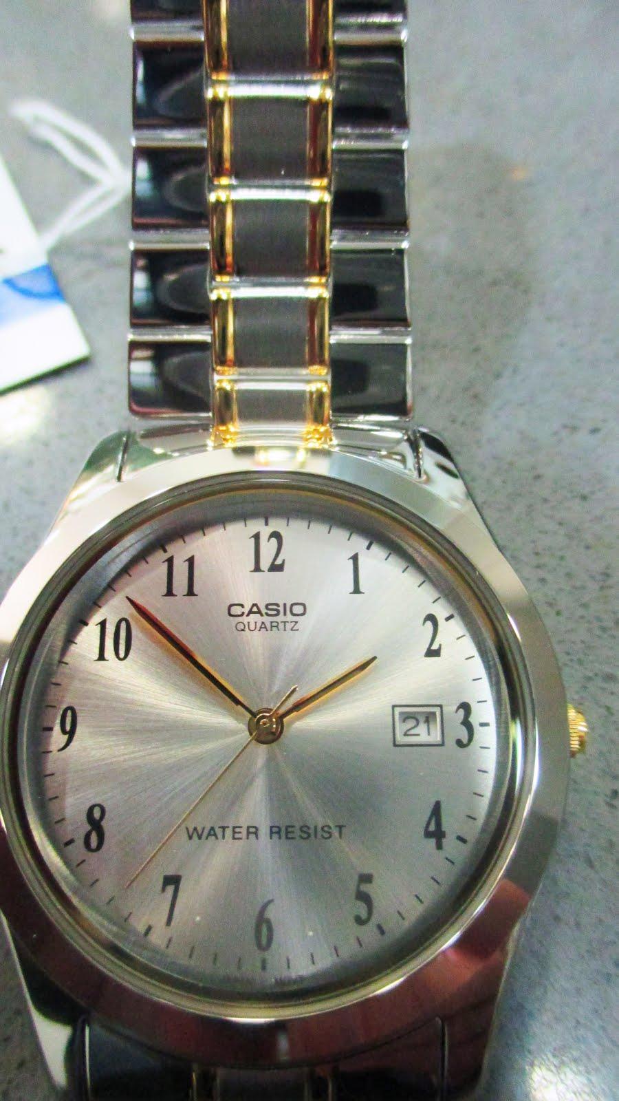 Reloj Casio, bicolor, caballero,..
