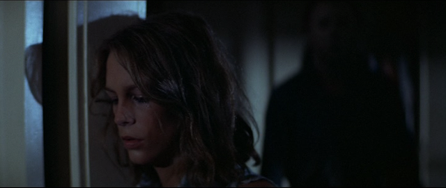 Laurie Strode (Jamie Lee Curtis) does not realize Michael Myers has risen behind her in HALLOWEEN (1978).