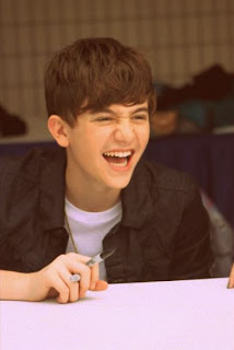 Greyson Chance at a meet and greet signing autographs