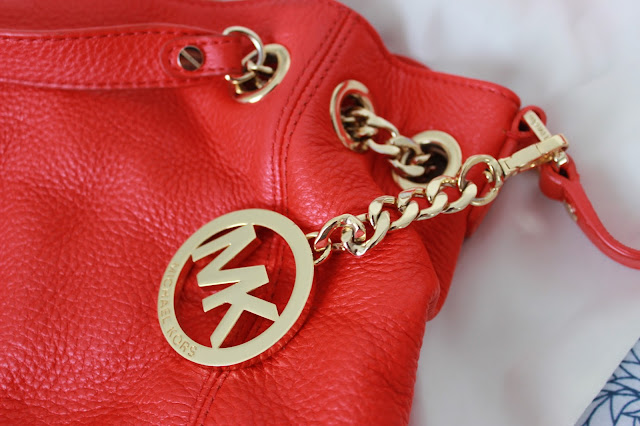 Blog sale red Michael Kors handbag  logo close up