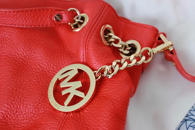 Blog sale red Michael Kors handbag  logo close up