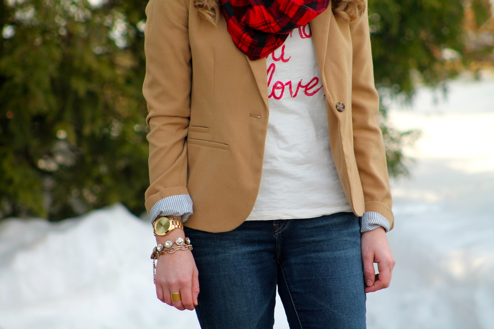 graphic tee and blazer with jeans and riding boots
