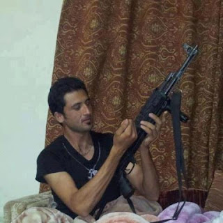 pakistani cricketer junaid khan with gun