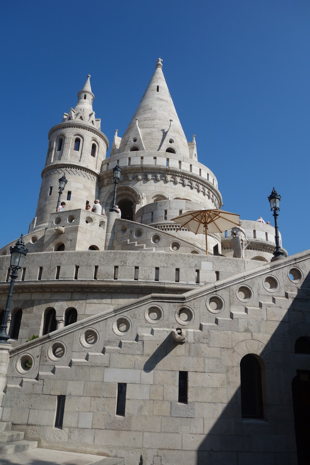 at the pinnacle of buda hill is the hapsburg palace which reminded me of a marble disneyland castle