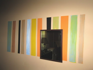 multicolor stripes on a wall mirror