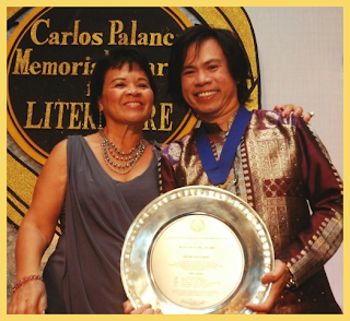 Peter with his mother holding plaque of Hall of Fame