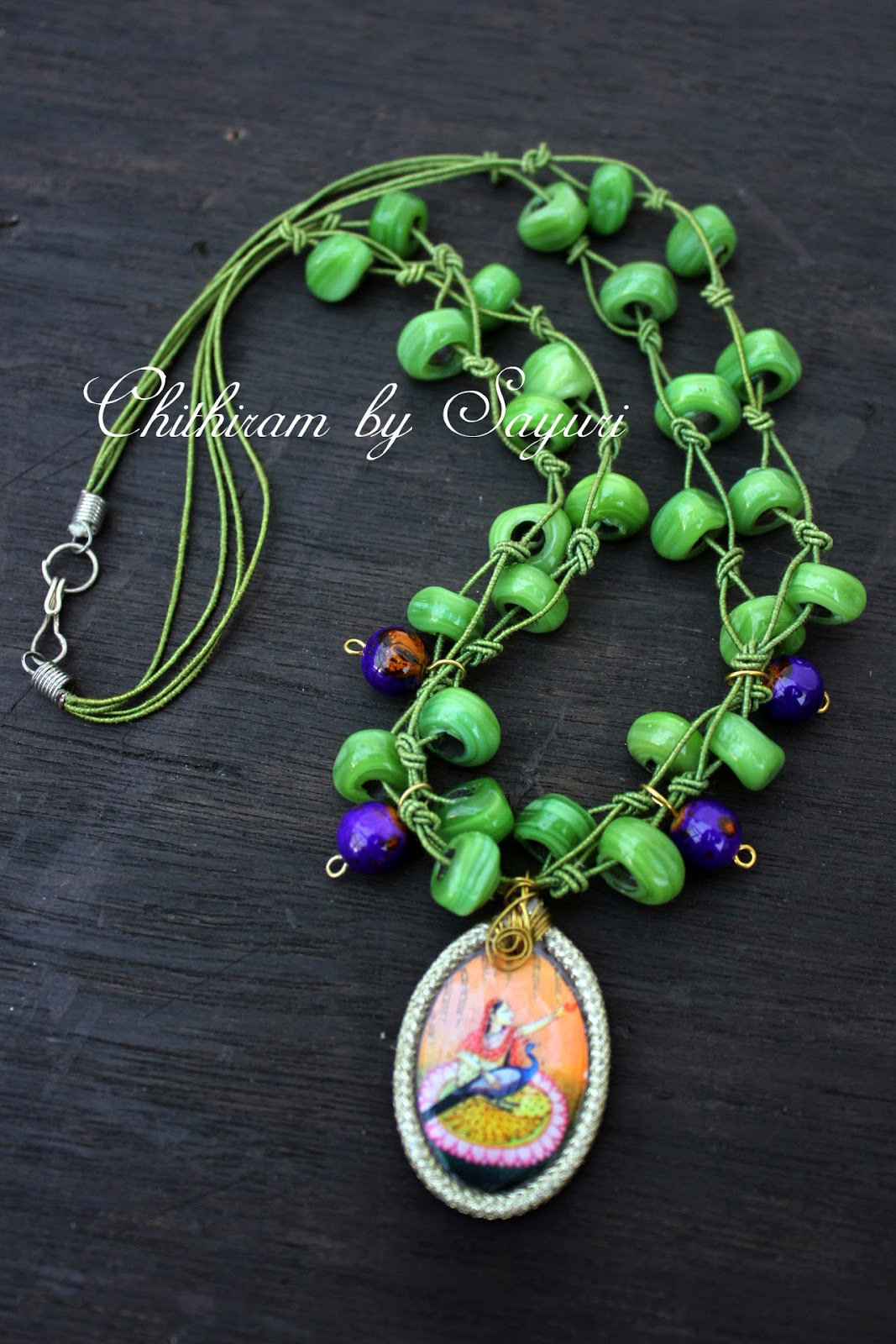 beaded necklace with decoupaged pendant
