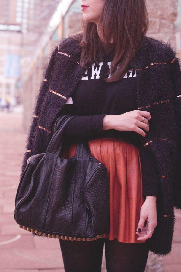 Mixing a furry statement coat with a sweatshirt and leather Alice & Olivia skirt