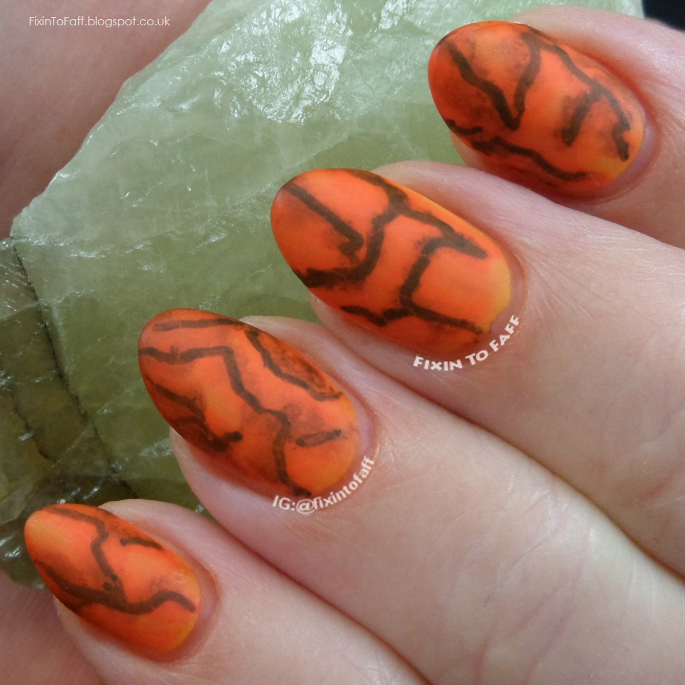 Permanent marker Sharpie marble nail art design.