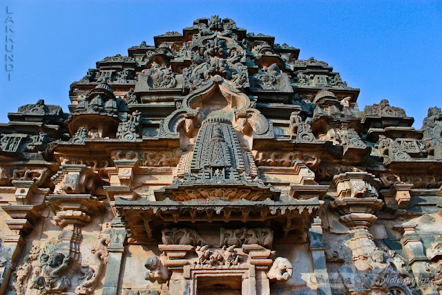 Kirthimukha (legendary face) with miniature tower–decorative arch combination going up the shrine superstructure
