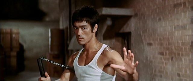 Bruce Lee with nunchucks in Way of the Dragon