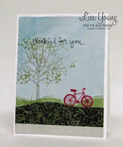 Stampin' Up! Sheltering Tree stamp set and Adventure Bound Paper as the sky and grass. A red bicycle gives it a pop of color.  Add Ink and Stamp