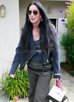 Cher carrying gift bags