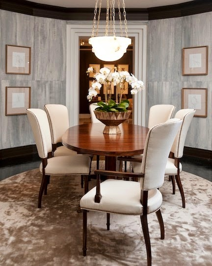 elegant dining room with gray striated walls round table