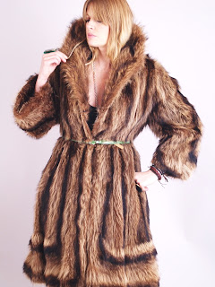 Vintage 1960's brown shaggy striped raccoon fur coat with large collar.