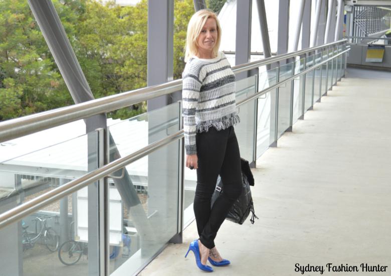Black Skinny Jeans, Black & White Sweater, Blue Pumps, Black Backpack