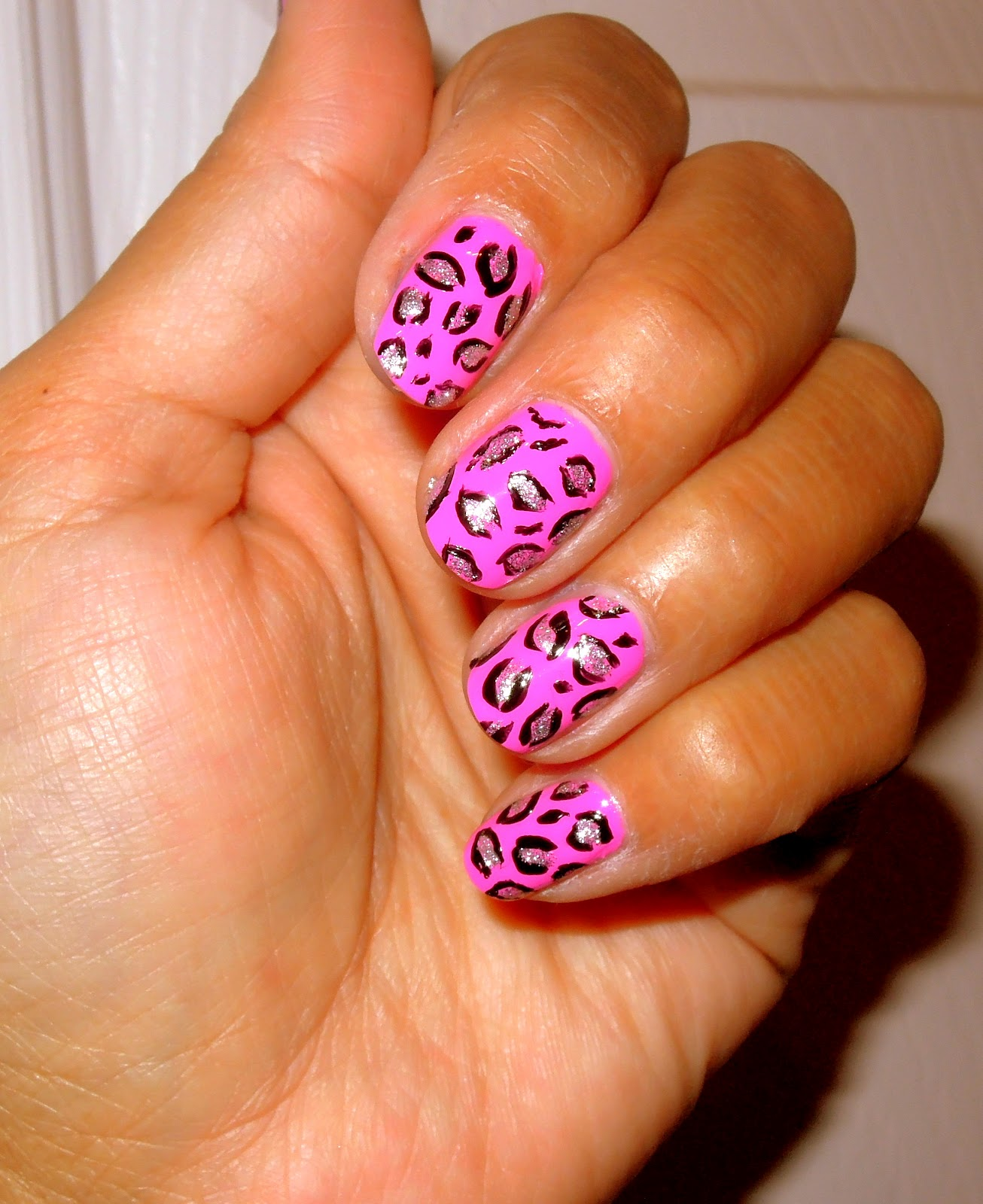beauty bizz pink animal print nails